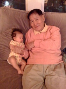 Hazel hanging on the couch with her great grandfather